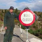 Moeraki resident and businessman John Beattie with the 'road closed' sign at the eastern  end of...