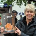 Montessori at Mosgiel manager  Lynlee Gallagher with a new  cookbook launched to raise money for...