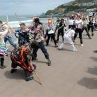 Morris dancers perform  at St Clair yesterday, during a visit to the city as part of a national...