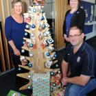 Mosgiel BNZ staff Jay Devlin (left) and  Genna Smart and Mosgiel Roundtable's Grant Gibson at the...