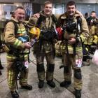 Mosgiel firefighters Richard Yardley (from left), Andrew McAuley  and Scott Lindsay after...