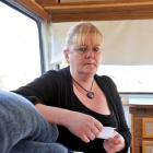 Mosgiel mother Carol Pine sits in her teenage son's caravan, holding his synthetic cannabis bill,...