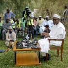 Muhammodu Buhari addresses a news conference outside his house after he voted in Daura in the...