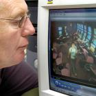 Murray Galland, of the Cableways Tavern, reviews CCTV footage of the woman alleged to have...