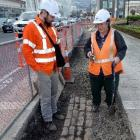 MWH project manager Cassino Doyle stands with  archaeologist Jill Hamel near the Dunedin Railway...