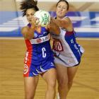 Mystics centre Temepara George (left) competes for the ball with Steel wing defence Wendy Telfer...