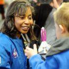 Nasa astronaut Stephanie Wilson talks to  Digby Langdon (left) and 10-year-old Carlos Urbino ...