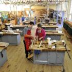 Nathaniel McMonagle (13) and teacher aide Linda Bates have the Kaikorai Valley College woodwork...