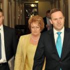 National leader John Key, right, with deputy Bill English and party president Judith Kirk arrive...