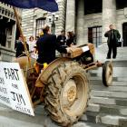 National MP Shane Arden drives a tractor called Myrtle up the steps at Parliament during a...