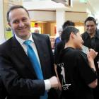 National Party leader John Key after parting with $20 to a youth at Coastlands Mall, Paraparaumu,...