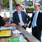 National Party leader John Key and deputy leader Bill English talk with Blair Payne, of...