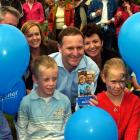 National Party leader John Key enjoys a campaign photo opportunity in Nelson. Photo by NZPA.