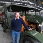 National Transport and Toy Museum curator Jason Rhodes with the 1915 Rover Sunbeam World War 1...