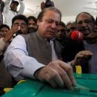 Nawaz Sharif, leader of the Pakistan Muslim League - Nawaz (PML-N) political party, casts his...