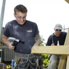 Naylor Love carpenters Aaron Shaw (left) and Eion Park work on an accommodation block at Dunedin...