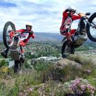 Nelson-based brothers Pete (17) and Nick Oliver (19) scale rocks above Alexandra yesterday in...