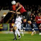 Nemanja Vidic (R) of Manchester United heads the ball past Darren Jones of Aldershot Town during...