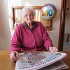 New centenarian May Watson enjoys her morning Otago Daily Times at her Oamaru home. Photo by...