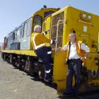 Andy Seymour (left) and Grant Craig of the Taieri Gorge Railway Trust check out the latest...