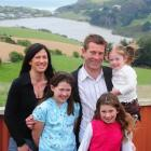 New National list MP Michael Woodhouse with his wife, Amanda, and daughters Emily (10), Isabel (8...