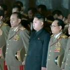 New North Korean leader Kim Jong-un (centre) stands among a row of top military officers,...