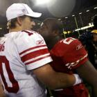 New York Giants quarterback Eli Manning (L), is congratulated by San Francisco 49ers running back...