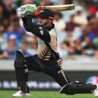 New Zealand batsman Colin Munro smashes the ball down the ground for six in his side's twenty20...