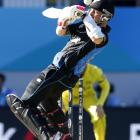 New Zealand's Brendon McCullum plays the ball off his helmet against Australia in their Cricket...