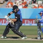New Zealand's Cory Anderson plays a shot watched by Afghanistan's Afsar Zaza (R) during their...