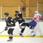 New Zealand's Hayden Argyle (centre) battles with Luxembourg's Benny Welter at the third division...