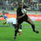 New Zealand's Joe Rokocoko slips a diving French tackle at Westpac Stadium. Credit:NZPA / Ross...