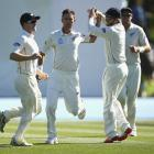 New Zealand's Trent Boult (2nd L) celebrates with teammates after taking the wicket of Australia...