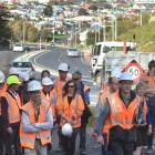 New Zealand Transport  Agency project manager Simon Underwood (fifth from the right) leads a...