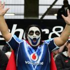 New Zealand Warriors supporter Phil George, of Auckland, makes his allegiance known during the...