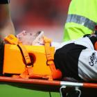 Highlanders captain Craig Newby leaves the field on a stretcher after injuring his neck while...