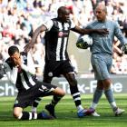 Newcastle United's James Perch falls to the ground after a confrontation with Liverpool...