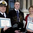 Former British citizens Captain Craig Holmes (left), Simon Kingsley-Holmes and Elizabeth Holmes...
