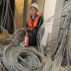 NHNZ technical and IT systems manager Wayne Poll inspects some of the 25km of cabling which is...