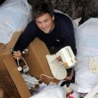 Nick Holmes (22) finds  a cake mixer in a skip behind a Dunedin store. Photo by Stephen Jaquiery.