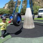 Nikau Moore (2), of Christchurch, enjoys the playground ...