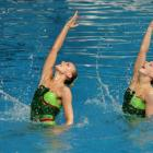 Nina (left) and Lisa Daniels compete in duel synchronised swimming. Photo from ODT files.