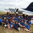 Ninety pupils from the Maniototo Area School wait to be shown around the DC-3 at Idaburn...