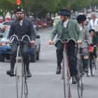 Noel Andrew (left) and Graeme Simpson lead a group of penny-farthing and safety cycle riders...
