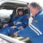 Norma Crooks, of Oamaru,  is belted into a  Toyota Starlet rally car by  driver Peter Fridd, also...