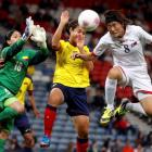 North Korea's Jon Myong-Hwa (R) and Colombia's Orianica Velasquez jump for a header as Colombia's...