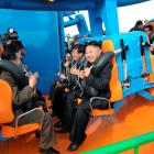 North Korean leader Kim Jong-Un prepares to take a ride with other high-level officials during...