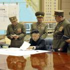 North Korean leader Kim Jong-un (seated) presides over an meeting on the Korean People's Army...