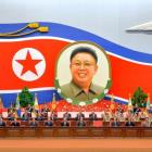 North Korean officials attend a national meeting to mark the 20th anniversary of late leader Kim...