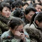 North Korean women cry after learning death of their leader Kim Jong-il yesterday. (AP Photo...